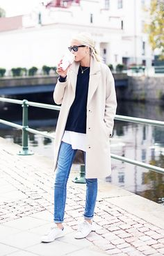 An untucked shirt, skinny denim, and white sneakers create a casual look around the coat. // #StreetStyle