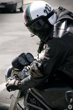 Like the look. Can't get cooler than an open faced helmet with dark goggles, and leather!