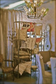 pillow display - You know, we don't always have to make a feature area look like a room.  It can also be a way to feature like items in a cohesive way.  Note all these pillows are color coordinated