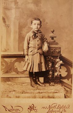 1890, a young boy named Henry Light poses in a dress.  Young boys often wore dresses in the 19th century, but by 1905 it was no longer a major fashion convention.