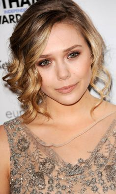 Bridesmaid Hairstyle: Elizabeth Olsen Rolls Light Curls Forwards To Frame Her Face, 2013 | Look