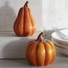 """Pumpkin Salt & Pepper Shakers -- Pier 1 Imports -- 9-6-16 -- Our happy couple of dolomite gourds can season your table from Halloween through the rest of fall. -- Orange -- Salt: 3""""Dia x 2.50""""H,     Pepper: 3""""Dia x 2.75""""H --     Dolomite -- Hand-wash only -- 2-piece set"""