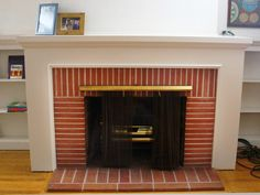 Terrific Free yellow Brick Fireplace Tips DIY Network's House Crashers takes you through beautiful fireplace makeovers. Get inspired to tra Brick Fireplace Remodel, Painted Brick Fireplaces, Wooden Fireplace, Fireplace Update, Brick Fireplace Makeover, Small Fireplace, Fireplace Hearth, Fireplace Surrounds, Fireplace Design