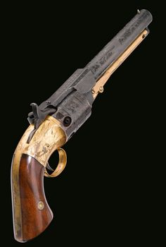 A cased and exhibition engraved Springfield Arms percussion navy revolver, circa 1851.  Former property of Capt. James E. Luce, captain of various transatlantic steamships in the mid 19th century.