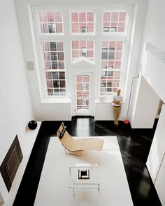 Black floor, white rug, huge windows: It doesn't get much more high-impact than that.