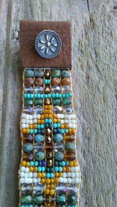 Boho chic bead loom bracelets Southwestern Native American Czech glass Japanese seed beads hand loomed this bracelet fit size 6 to 8 inch wrist is 1 inch wide and closes with a handmade sterling silver button