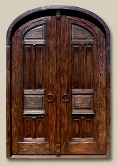 Master Bedroom Doors Crafted with antique Mexican doors and salvaged woods. Features antique carved  astragal and heavy iron pull rings with round escutcheons. 8085A Wilemon