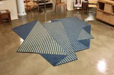 A Rug That Resembles a Folded Sheet of Paper