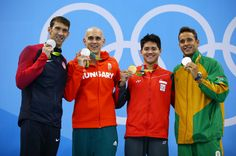 (R-L) Joint silver medalists, Michael Phelps of United States, Chad Guy Bertrand le Clos of South Africa, Laszlo Cseh of Hungary and gold medalist Joseph Schooling of Singapore celebrate on the podium during the medals ceremony in the Men's 100m Butterfly Final on Day 7 of the Rio 2016 Olympic Games at the Olympic Aquatics Stadium on August 12, 2016 in Rio de Janeiro, Brazil.