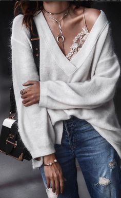 Always love Erica's styling... here she is wearing an oversized cashmere sweater over a lace cami for those chilly spring evenings or summer nights. // Photo by Erica from Fashioned Chic