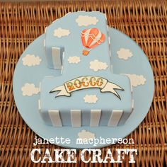 - Vintage hot air balloon cake. Boys first birthday. Hand painted name plaque