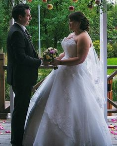 This tiered plus size wedding gown skirt has lightly beaded lace details.  This strapless wedding gown can be recreated for you in your exact measurements with any change you need. Get pricing and more details on custom #weddingdresses & replicas of designs for less at www.dariuscordell.com