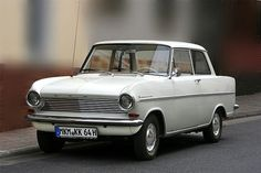 My FIRST car--1965 Opel Kadett.  Mine was light mint green with a white top.  39.5 HP, 4 speed manual.  An old car with great character.