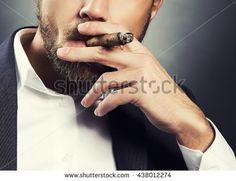 stock-photo-close-up-hand-of-bearded-caucasian-man-smoking-a-cigar-wearing-grey-suit-and-white-shirt-studio-438012274.jpg (450×347)