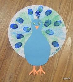 Peacock Craft- fingerpaints and glue.  Bridget's favorites.