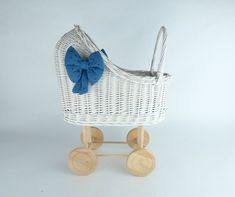 Wiklibox wicker & alder wood doll stroller with soft muslin bedding and bows - available in many colours. Polish product by WIKLIBOX on Etsy Dolls Prams, Bassinet, Wicker, Little Girls, Bedding, Polish, Bows, Colours, Handmade Gifts
