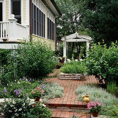Add Drama Give small gardens a big boost of style by adding an oversize gate or arbor at one end to act as a focal point. It will draw the eye in and make the space seem larger. Here, a large-scale ornamental entry arbor gives this tiny side yard some visual heft. Plus, it supports a crown of climbing roses. White lilies in the center bed mirror the white roses and arbor.