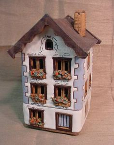 Pottery tea light house