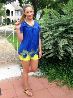 Cobalt blue top, neon lime green shorts, bright pink lips, statement necklace.