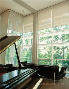Conveniently control early-morning sun with Lutron motorized shades. http://www.lutron.com/en-US/Residential-Commercial-Solutions/Pages/Residential-Solutions/ShadingSolutions.aspx?utm_source=Pinterest&utm_medium=LivingRms_ButzPiano&utm_campaign=SocialMedia
