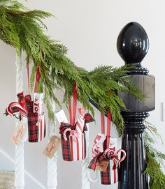 Sweeten a garland with welcome gifts. Offer treats to overnight guests as they head up to their temporary digs by hanging coffee mugs filled with candy and hot cocoa mix on the banister garland.
