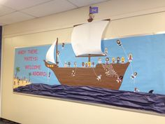Back to School Bulletin Board. Welcome Aboard pirate ship with teacher and staff faces on paper dolls.