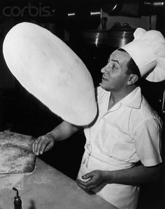 Pizzaiolo at work in NYC Pizza Parlor Circa 1950.