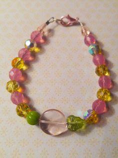 Roze en olijfgroene kristal AB en Tsjechisch glas armband blaadje pompoen via Birdie Accessoires