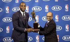 Miami Heat's LeBron James, left, and Kia Motors' Percy Vaughn pose for photos during an NBA basketball news conference, Sunday, May, 5, 2013, in Miami. James was formally announced as having won his fourth Most Valuable Player award at the ceremony. And just this year, Kia and James announced they had entered into an endorsement partnership. (