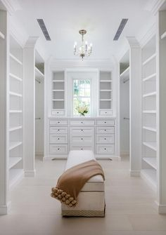 A long beige skirted bench sits on a wide plank wood floor in a white custom closet lit by a George II Mini Chandelier. Master Closet Design, Custom Closet Design, Walk In Closet Design, Master Bedroom Closet, Closet Designs, Custom Walk In Closets, Dream Closets, Small Closets, Closet Renovation
