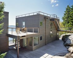 Image 8 of 11 from gallery of Ledge House / Theodore + Theodore Architects. Courtesy of Theodore + Theodore Architects Residential Architecture, Modern Architecture, Timber House, New England, Interior And Exterior, New Homes, House Design, Patio, Outdoor Decor