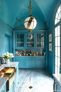 Blue lacquered walls and trim; Zodiac Lantern from Visual Comfort; vaulted ceiling, inspired by the iconic mural at Grand Central. Philip Shutze house in Atlanta. Designer: Miles home design