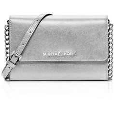 Michael Michael Kors Jet Set Travel Metallic Crossbody (£105) ❤ liked on Polyvore featuring bags, handbags, shoulder bags, purses, silver, silver metallic handbag, metallic shoulder bag, cross body travel purse, metallic purse and travel purse
