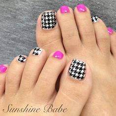 A quirky looking checkered inspired toenail art design. Colors used on this design are fuchsia, black and white. Checkered shapes are then created by using the black and white polishes. The other nails are then coated in matte fuchsia.