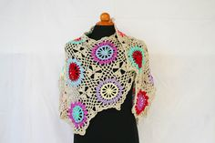 A very unique crochet wrap or shawl in Chaos style colors - colors are bright and random and are connected with single or main color. The wrap or shawl itself shaped like a V, and it's very stylish and easy to style as you want it. This wrap is light, warm, and it has beautiful texture of colorful hexagons. It is made from 100% soft Acrylic yarn. I