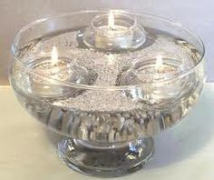 Floating votives in silver liquid
