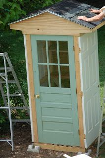 garden shed made from 4 old doors to hold garden supplies