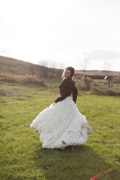 As the sun sets on your reception, take the chill off your farm/field/forest wedding with your favorite flannel shirt. How cute is this plaid shirt used as a bridal shrug? It adds an unexpectedly sweet casualness to an otherwise gorgeously formal gown. **** Via Style Me Pretty. Photography By Dani Stephenson