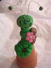 caterpillar on upside down clay pot