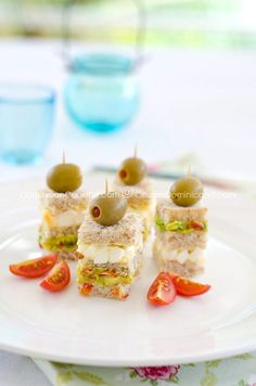 I love, love these delicious triples(triple-layered mini-sandwiches). They are perfect for parties and get-togethers. I'm sure I'm not alone when I say that entertaining can sometimes be a stressi...