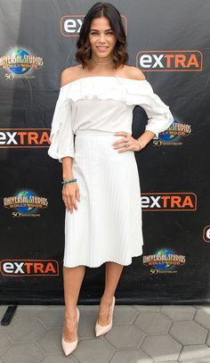 Jenna Dewan-Tatum in a white off-the-shoulder L'Agence top, pleated midi skirt and nude heels