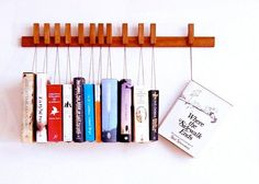21 chic ways to decorate your apartment with books - etsy book hanger