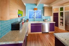 You say you want some color? How about orange, purple, and turquoise??? Concrete counters with recycled glass!