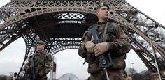 French soldiers patrol in of Paris's Eiffel Tower.