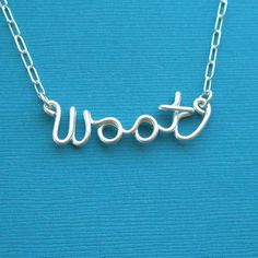 woot (sterling silver wire word necklace). $37.00, via Etsy.