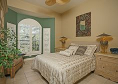 Traditional Master Bedroom with Ceiling fan, High ceiling, limestone tile floors