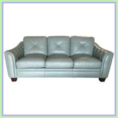 View this item and discover similar for sale at - Soft teal blue leather sofa having diamond pattern on the arms with detailed stitching. Large and comfortable, all cushions detach.