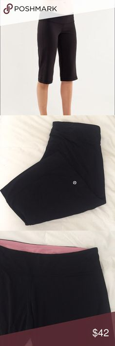 "Lululemon Black Clam Digger Yoga Crops size 12 This is a pair of Lululemon Crop Clam Diggers. Size 12. Black with pink inside waistband. Waist 33"" inseam 34"" rise 8"" leg opening 10"". Great condition. lululemon athletica Shorts"