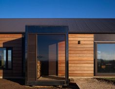 The Hill Plain House by Wolveridge Architects - the juxtoposition of a pitched roof and flat roof entry