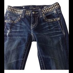 📌SALE 📌Miss Me Dark Rinse BLING Skinny Jeans I personally don't understand these jeans, but maybe it's because I'm old and my fat a$$ doesn't fit in them. Studded with bling, these gorgeous jeans are full of personality.  Perfectly distressed and feathered with a dark rinse. Excellent pre-loved condition. Smoke free, pet free home.  98% Cotton/ 2% Elastin for just the right amount of stretch. Measurements taken with jeans lying FLAT, compare to your favorite jeans.  Waist: 14.5 in…